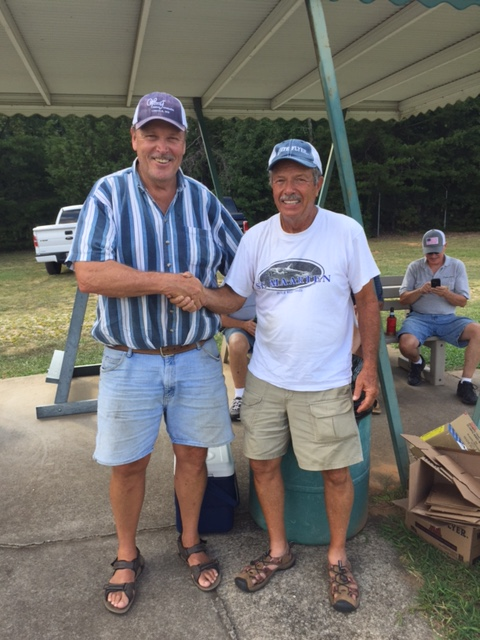 Doug Stenback was congratulated by ATA Delegate Jim Faber on reaching the 75,000-target milestone in singles.