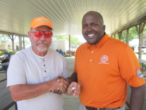 Bill Otter was presented his pin for reaching the 100,000 singles milestone by ATA Central Zone Vice President Darryl Hayes.