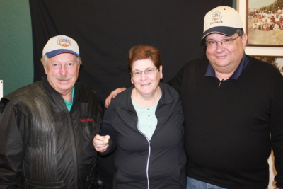 Joyce Morris (middle) was presented her 75,000 handicap pin by ATA Eastern Zone Vice President Paul Shaw and New York Delegate Dave Cichelli.